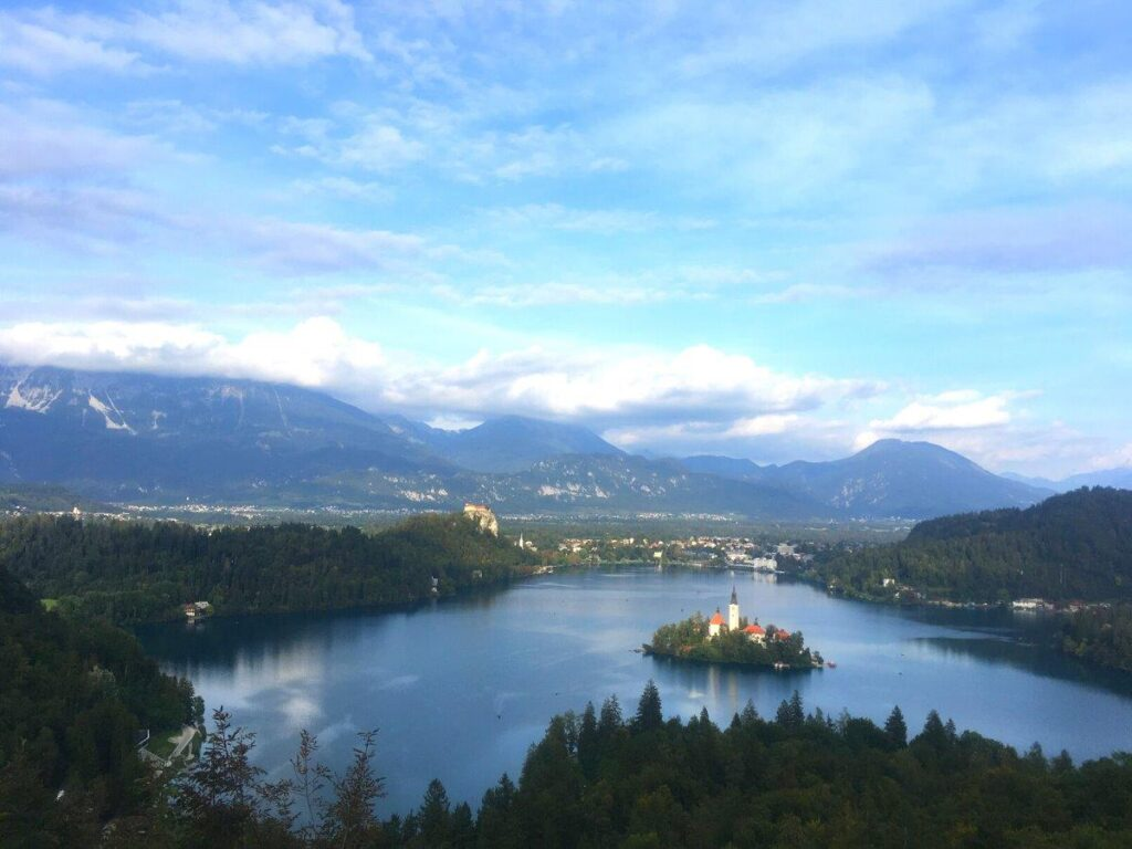 The view from Ojstrica, Bled's best viewpoint that shows the Julian Alps, Bled Island and Bled Castle