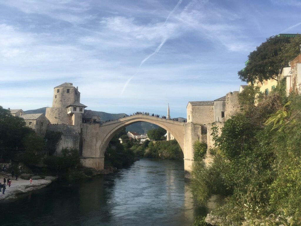 View of the Mostar Bridge from the river level on the west side