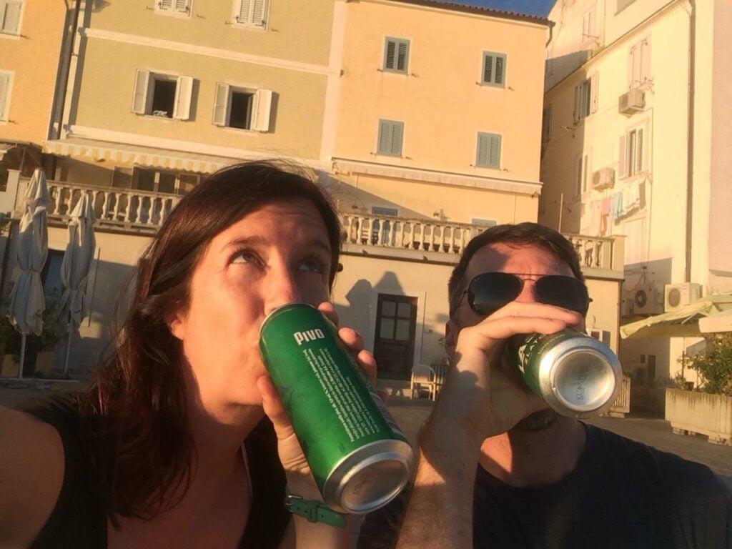 People having a sunset drink on promenade at Piran Slovenia