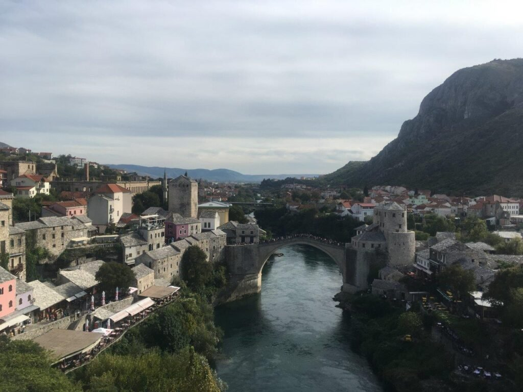 View of Old Bridge, river and city of Mostar from above