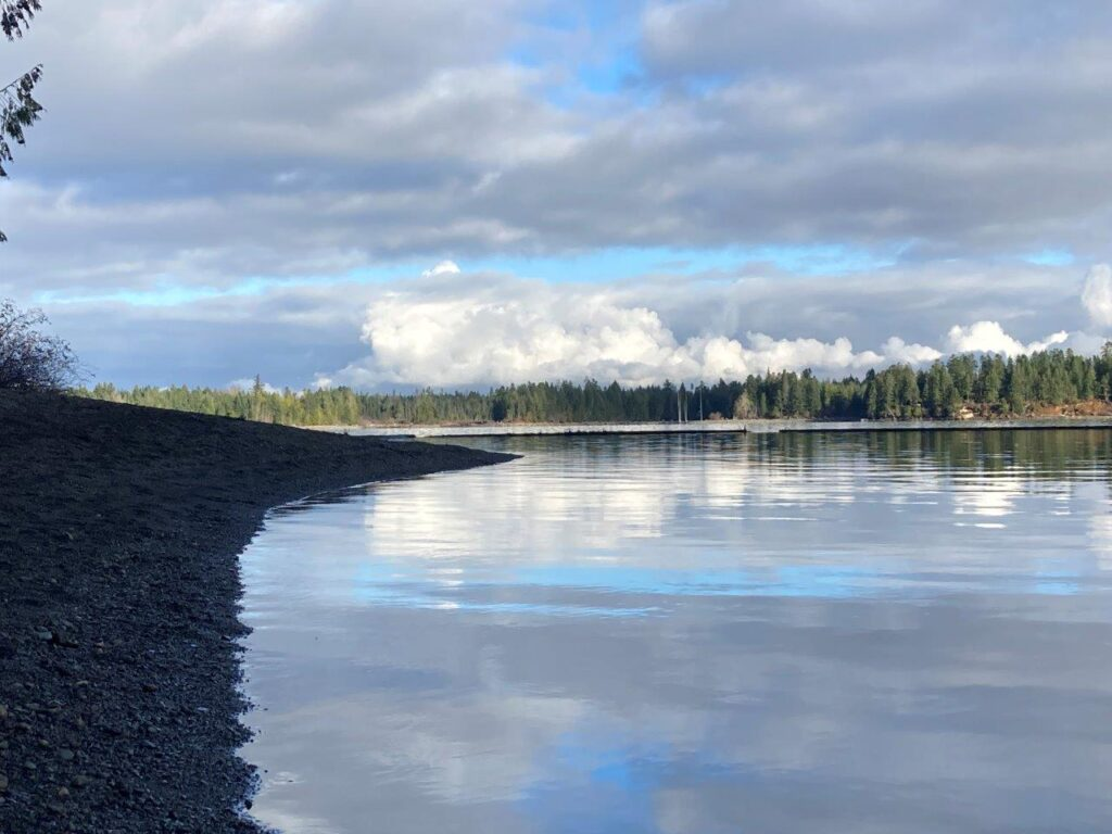Cloud reflections in Comox Lake near Cumberland BC