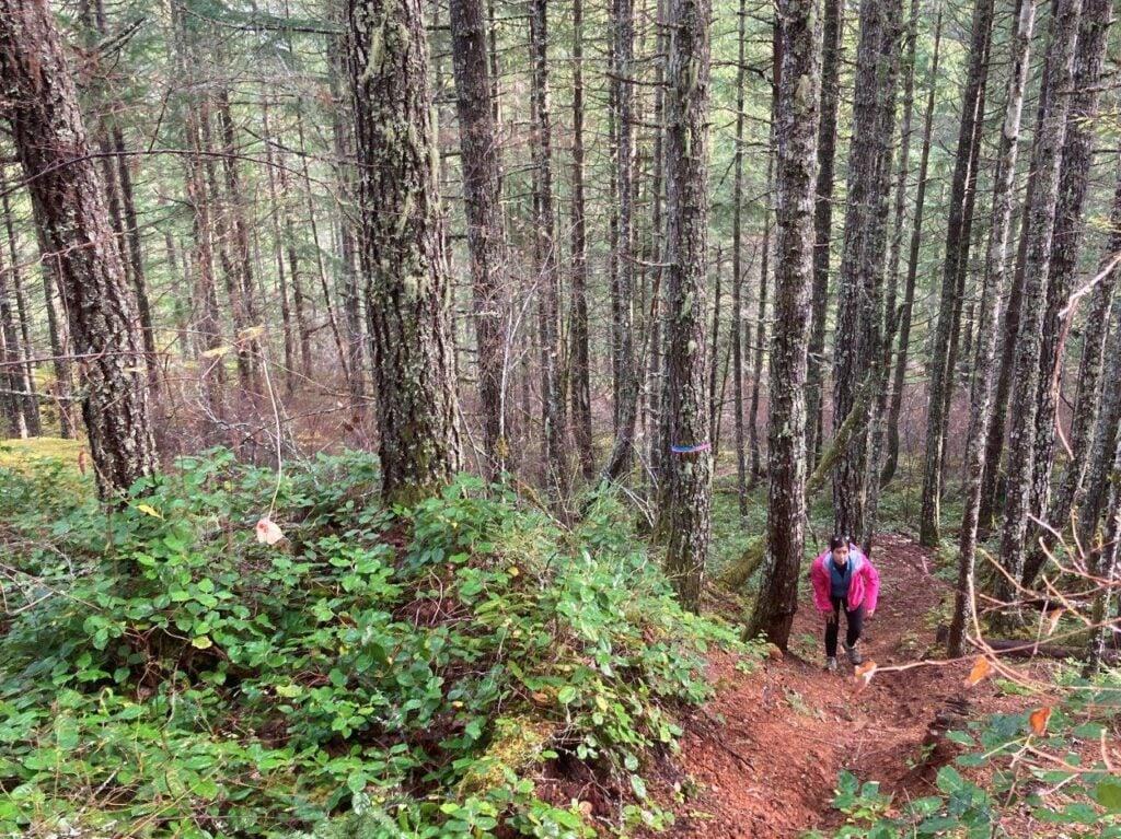 Woman climbing hill on Comox Lake trail