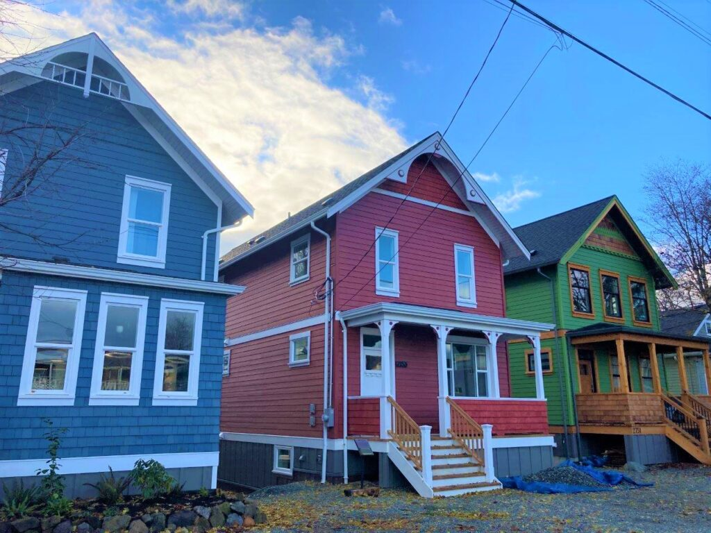 Three houses brightly painted in Cumberland bc