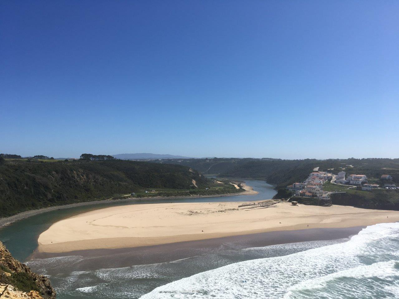 The river and Odeceixe beach with ocean waves on the Costa Vicentina