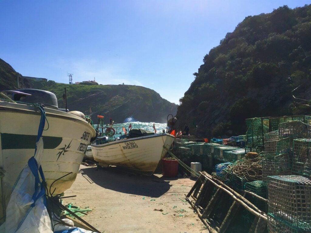 Old fishing boats near Zambujeira do Mar Portugal