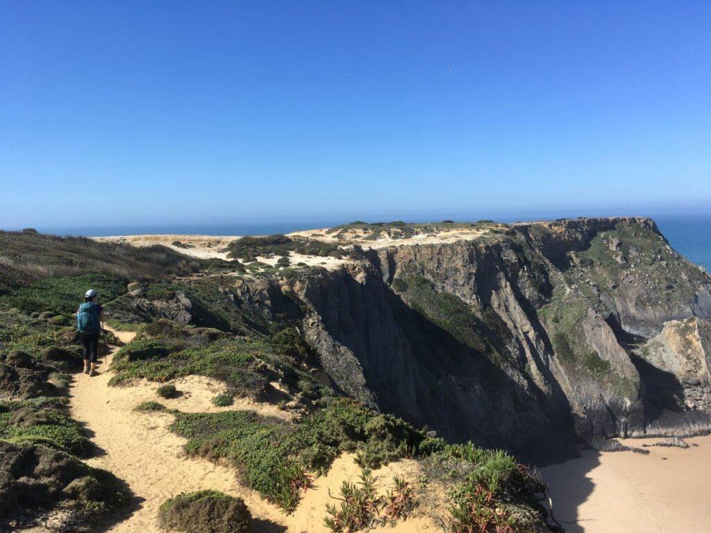 Woman walking on cliff trail near Zambujeira do Mar Portugal