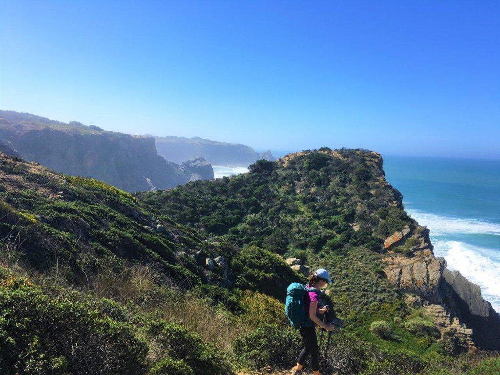Woman hiking on Rota Vicentina trail near Zambujeira do Mar Portugal