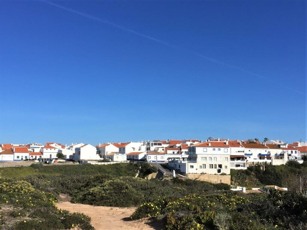 View of the white buildings and red roofs of Porto Covo Portugal