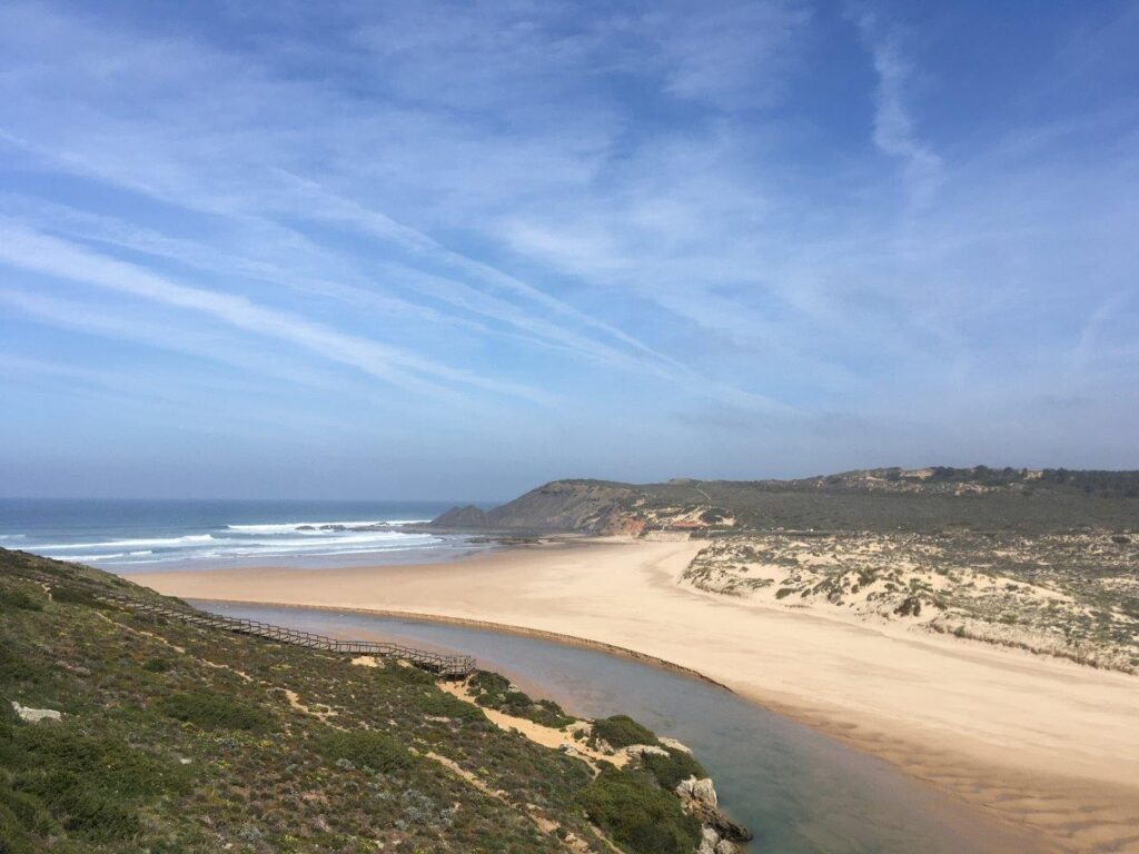 Beach with a river beside it viewed from the neighboring cliff on the Costa Vicentina