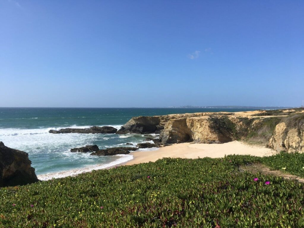 Praia de Circa Nova beach and cliffs from a distance near Porto Covo Portugal