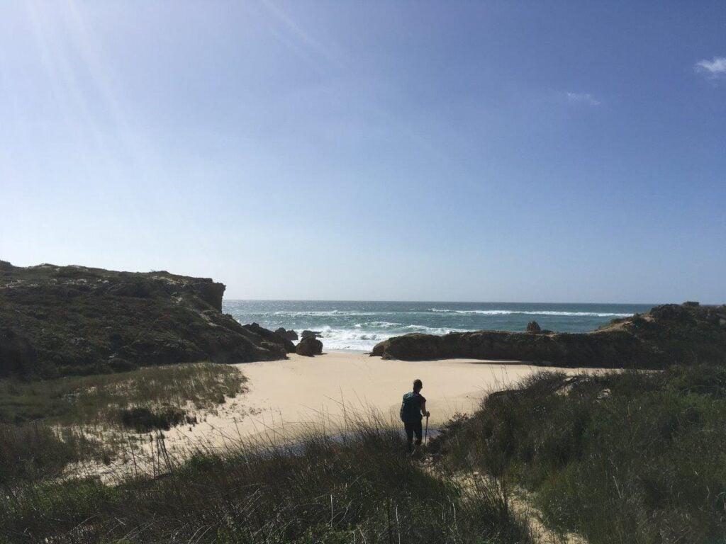 Woman walking down to a beach near Porto Covo Portugal