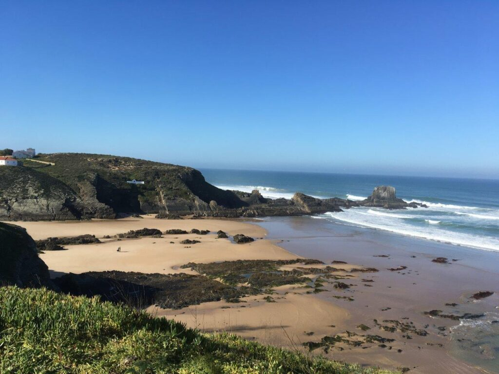 Zambujeira do Mar beach with cliffs on both sides