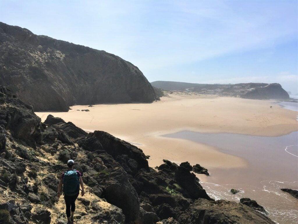 Hiker on trail toward beach on Costa Vicentina Portugal