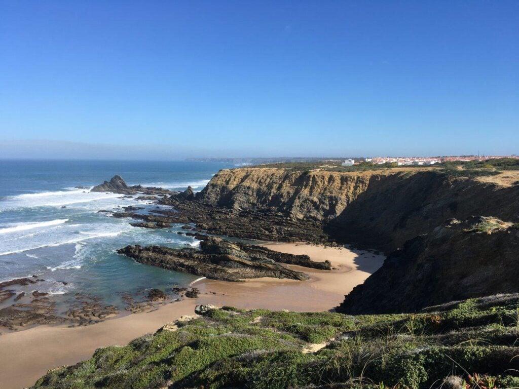 View of Praia dos Alteirinhos near  Zambujeira do Mar at low tide from the cliffs