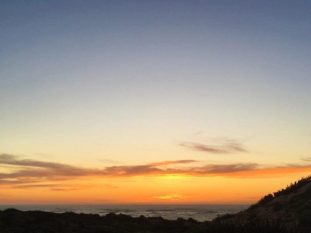 Sunset over the ocean from the dunes of Vila Nova de Milfontes Portugal
