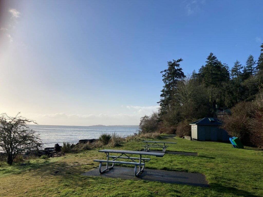 Picnic tables, garbage recepticles and outhouses near Witty's Lagoon beach