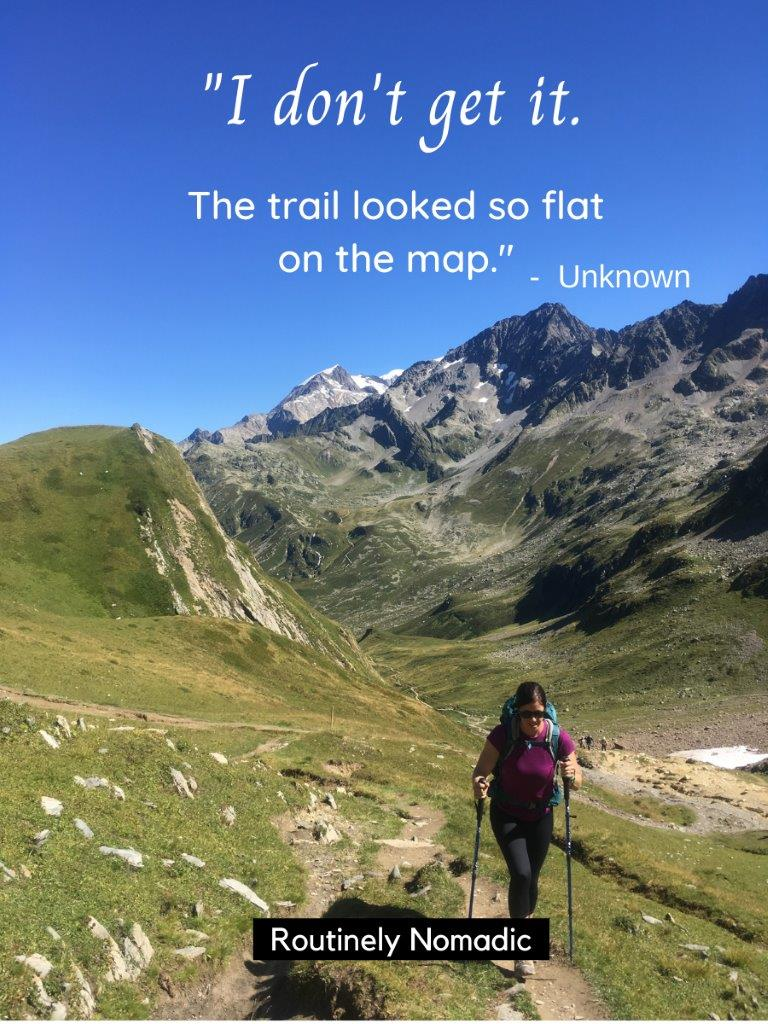 woman walking up trail with moutains behind and a funny hiking quotes and funny hiking captions on top