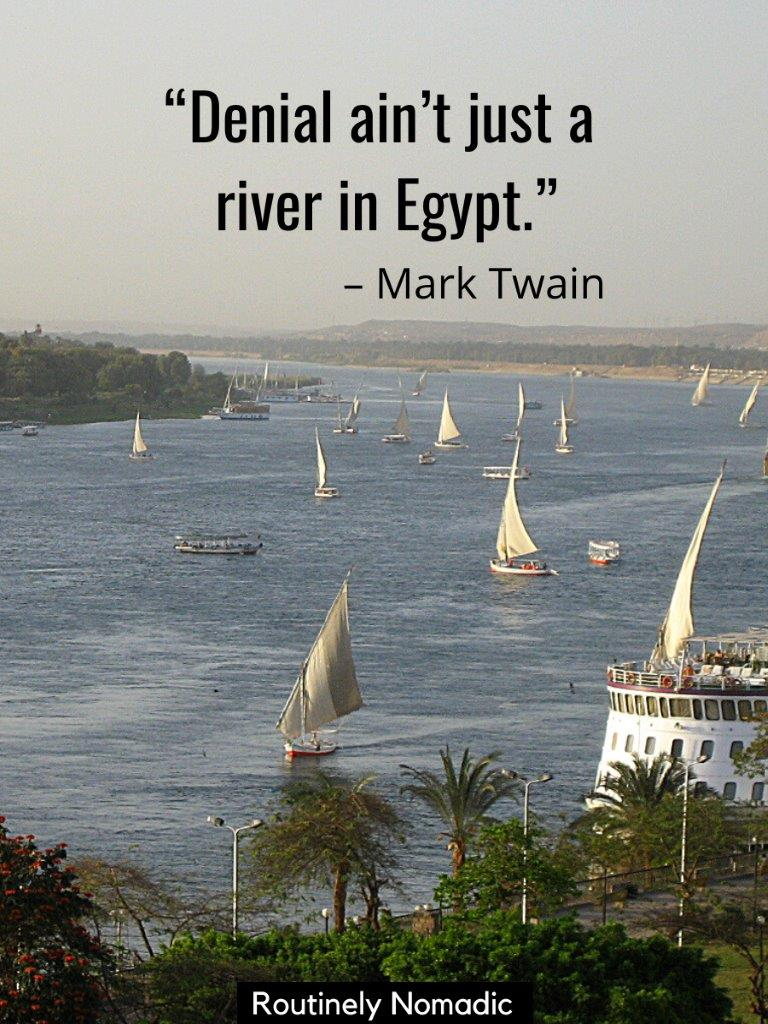 Fellucas sailing on the Nile with a funny river saying on top
