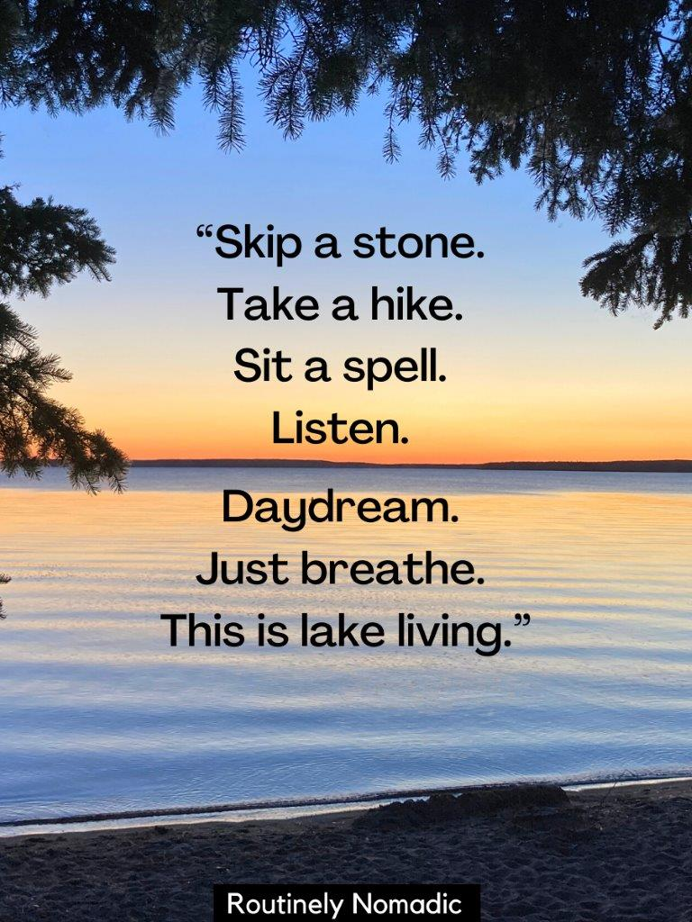 Sunset over al calm lake with tree branches in front with a lake life quotes on top