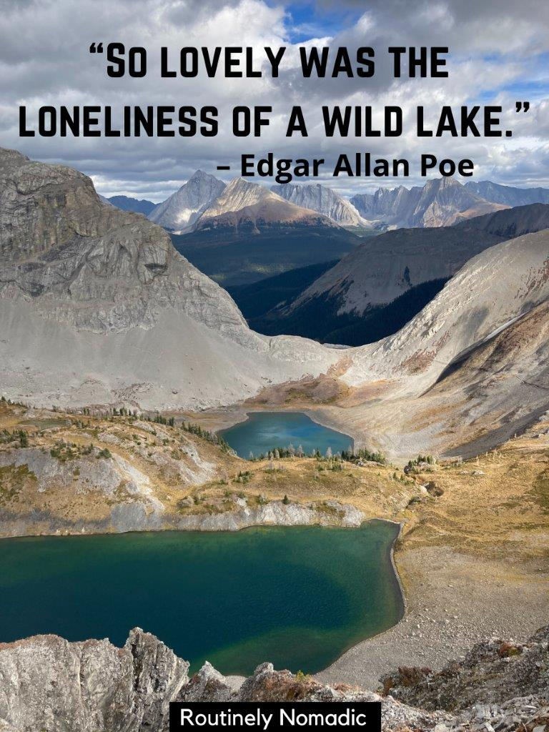 Two green alpine lakes with mountains in the background and a lake sayings on top