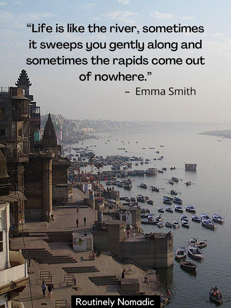 View from above of the Ganges with buildings on one side and many boats an a life is like a river quotes on top