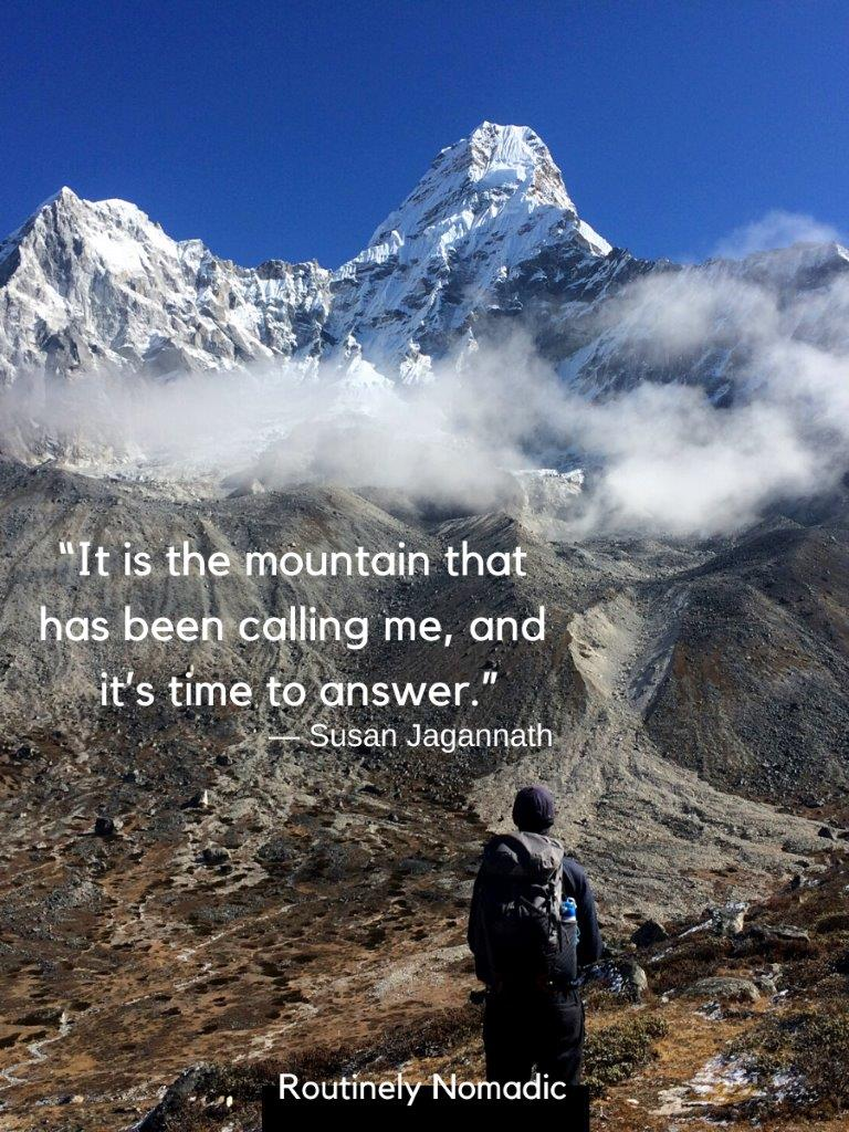 Picture of man standing in front of pointy mountain with a mountaineering trekking quotes on top