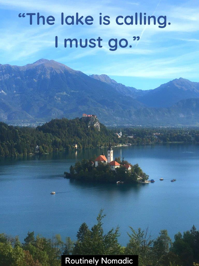 A lake with a island in the middle with a church on it and mountains in the background and a short lake quotes on top