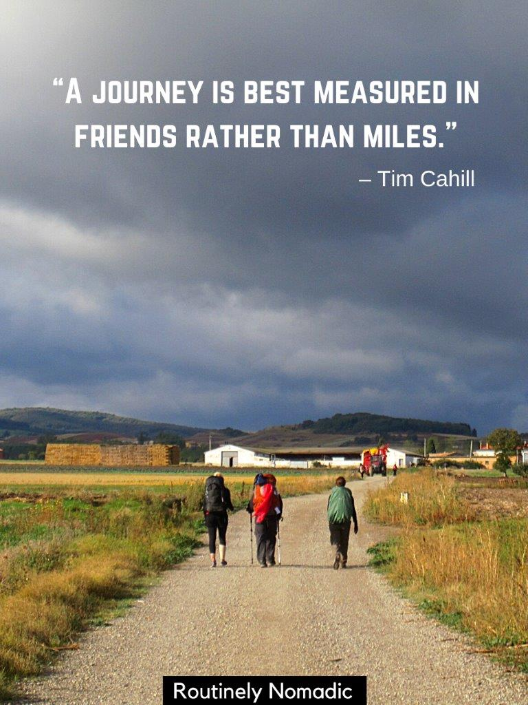 Three people with backpacks hiking on road with storm clouds above with a trekking with friends quotes on top
