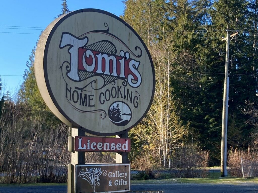 Sign for Tomi's home cooking in Port Renfrew, BC
