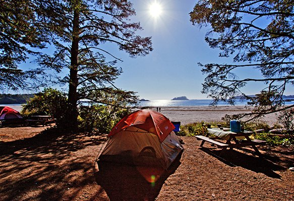 Tent and picnic table in front of beach and ocean at Bella Pacifica Campground, one of the best camping in Tofino options