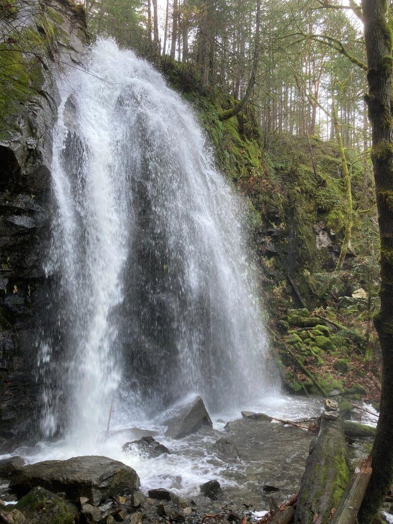 One of the best waterfalls on Vancouver Island - Christie Fallls with green trees