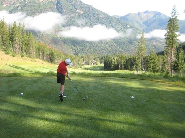 man golfing with mountains in background - one of the best things to do Invermere