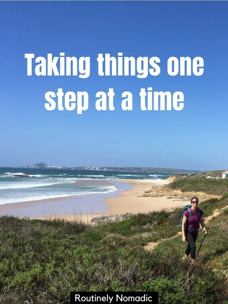 Woman walking on sandy path by ocean and beach with hiking captions for Instagram that reads taking things one step at a time