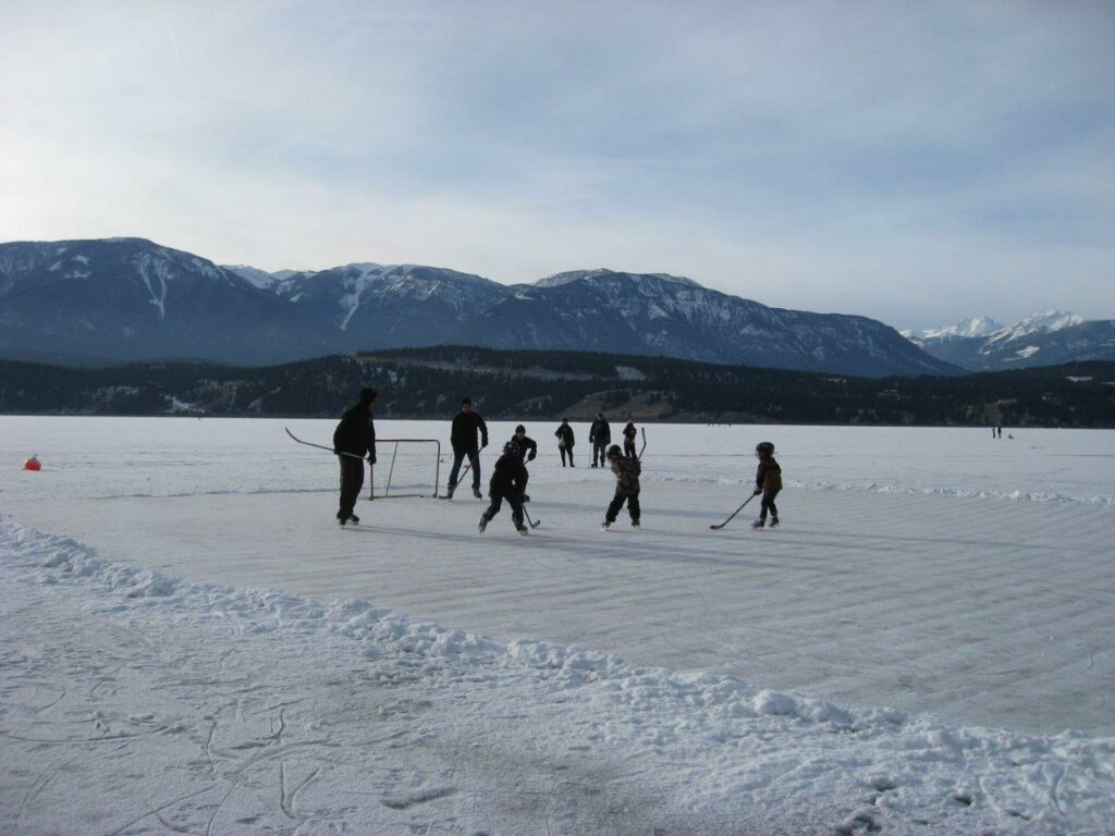 Family playing hockey on lake - one of the best things to do in Invermere