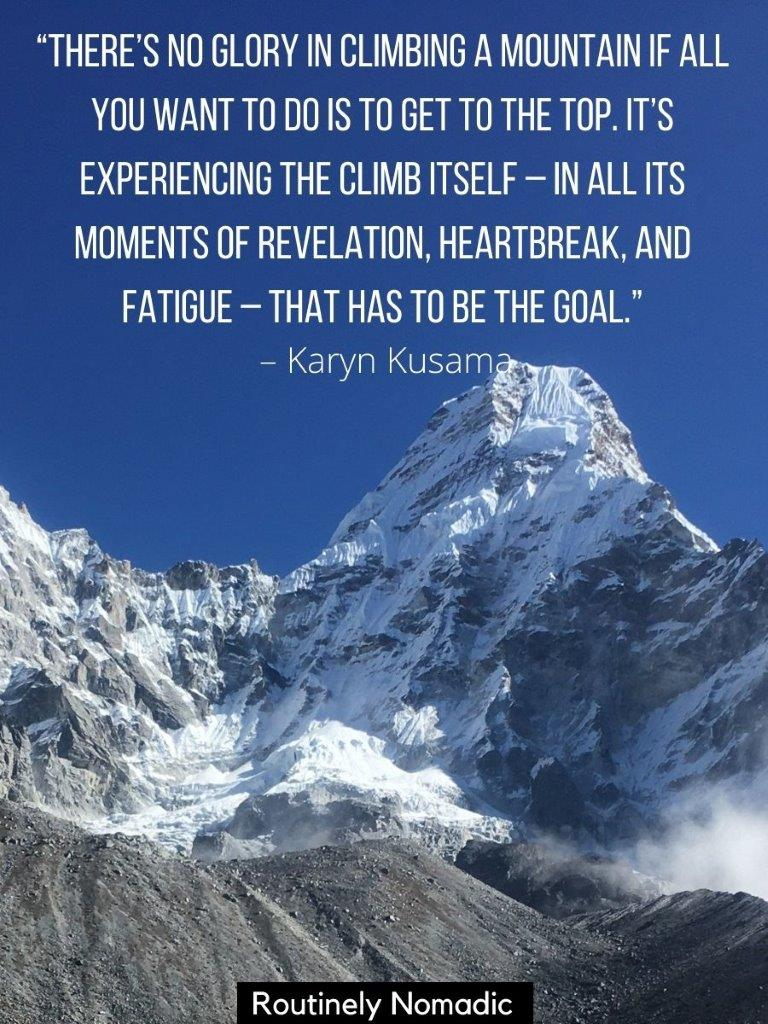 Mountain covered in snow with a inspirational quotes about mountain climbing on top
