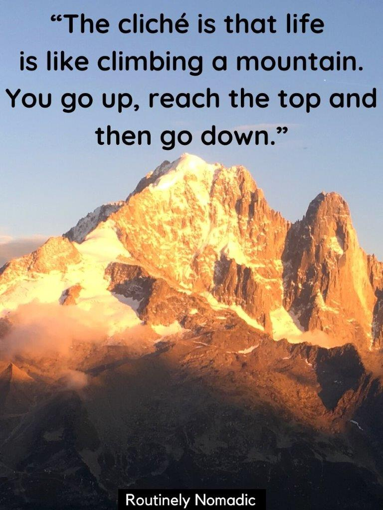 Mountain at sunset with yellow glow and a life is like climbing a mountain quote on top