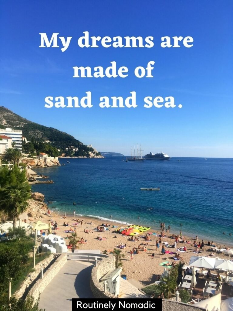 Busy beach in front of deep blue sea with a sea beach captions that reads my dreams are made of sand and sea