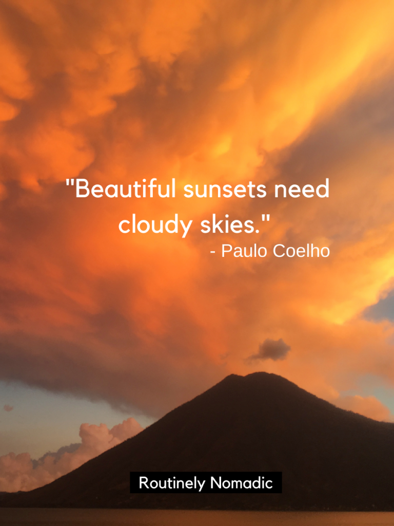 Orange clouds over a volcano with a short sunset captions on top that reads beautiful sunsets need cloudy skies
