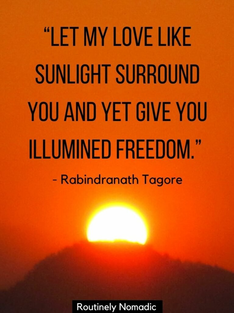 Sun almost behind a hill and an orange sky with a sunlight love quotes on top