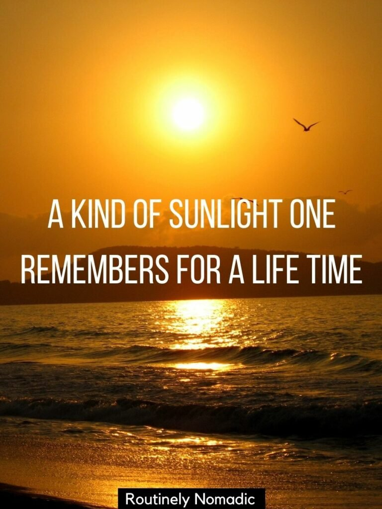 Golden sun setting on an ocean with waves coming into the beach with a sunlights captions for Instagram on top that says a kind of sunlight one remembers for a life time