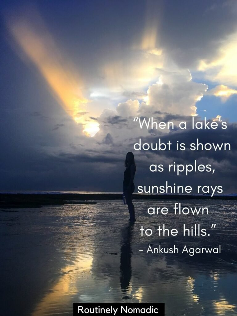 Woman standing silhouetted in the water with a dark sky and a sunray with a sunrays quote on top