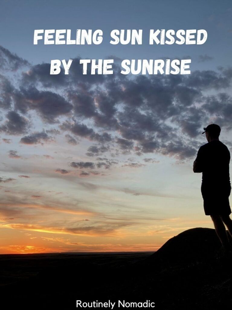 Person silhouetted at sunrise with a sunrise captoins that reads feeling sun kissed by the sunrise