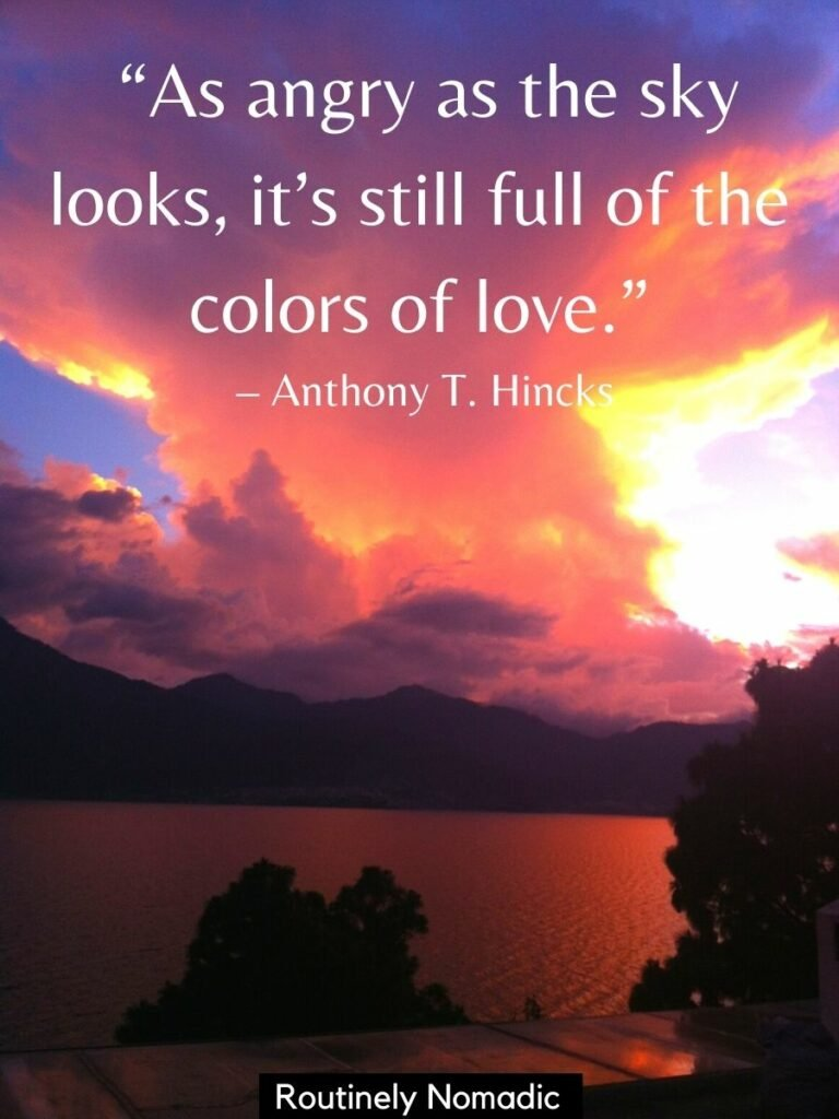 Pile of clouds with sunset colors over a volcano with a short sunset quote that reads as angry as the sky looks its still full of the colors of love