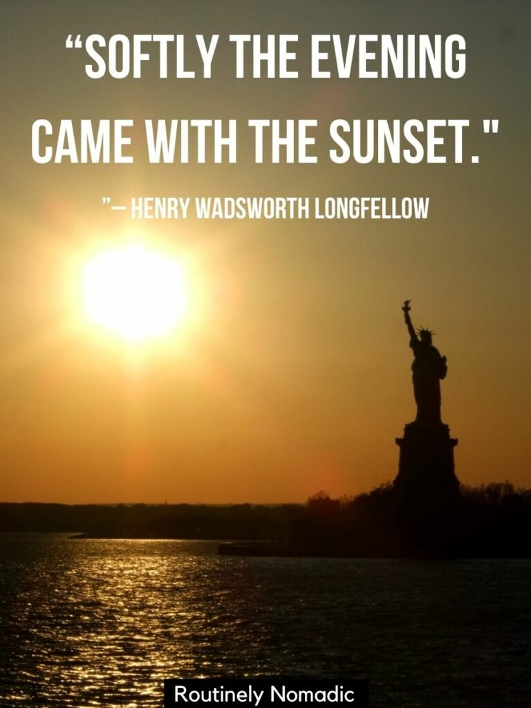 The sun setting beside the statue of Liberty with a sunset caption -short saying softly the evening came with the sunset