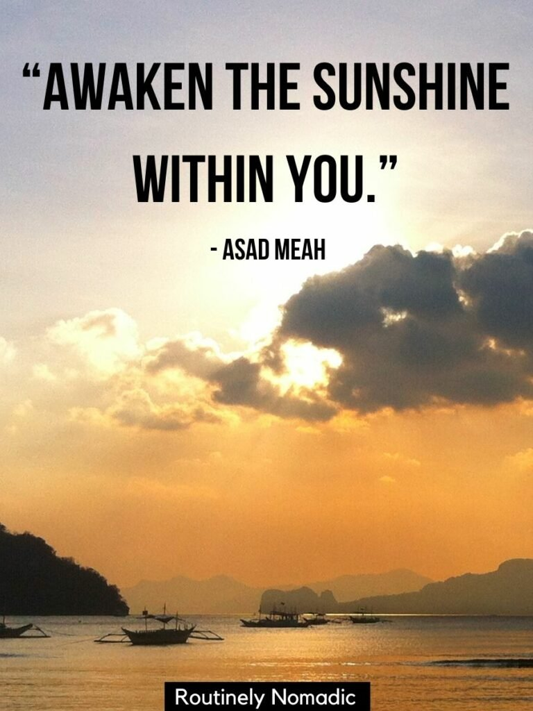 The sun shining through a cloud on a ocean with boats and a short sunshine quotes for Instagram that reads awaken the sunshine within you
