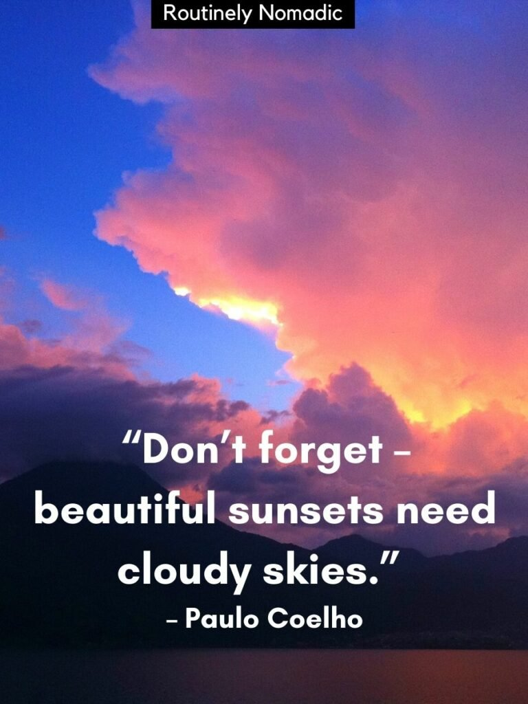 Volcanoes with pink clouds and blue skies and a beautiful sunset quotes that reads don't forget beautiful sunsets need cloudy skies by Paulo Coelho