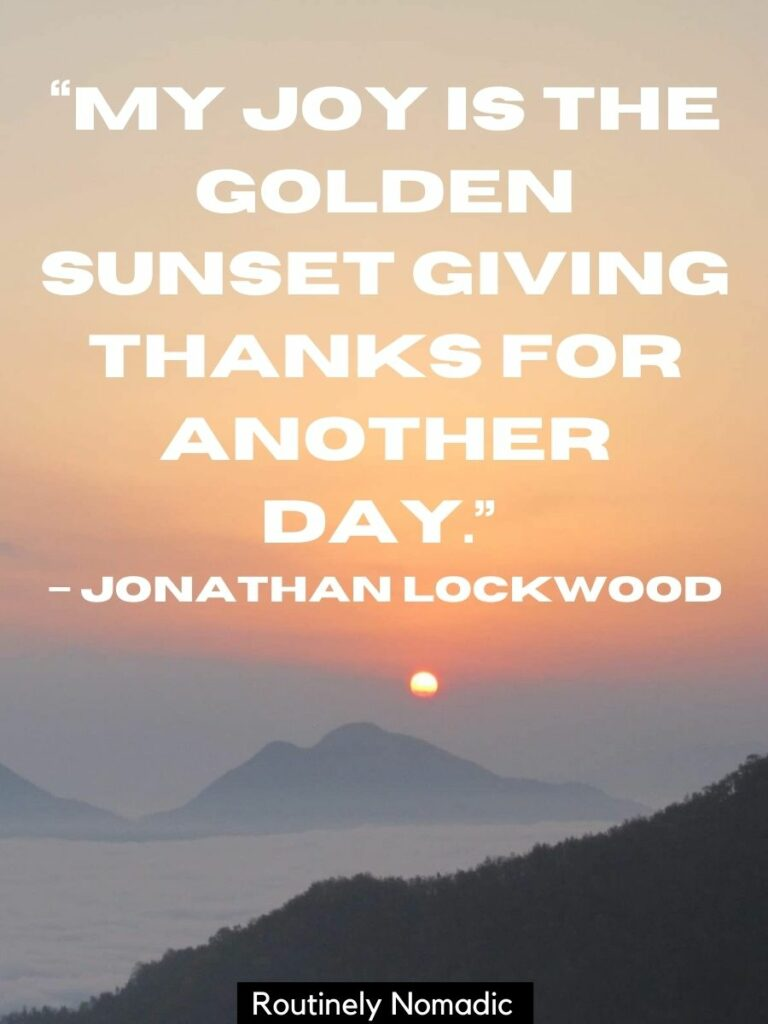 Mountains tops above the clouds and a the setting sun with a beautiful sunset quotes that reads my joy is the golden sunset giving thanks for another day