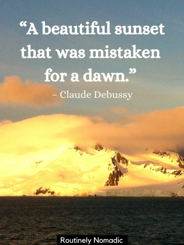 Snow covered mountain in behind the water with a beautiful sunset quotes by Claude Debussy that reads A beautiful sunset that was mistaken for a dawn