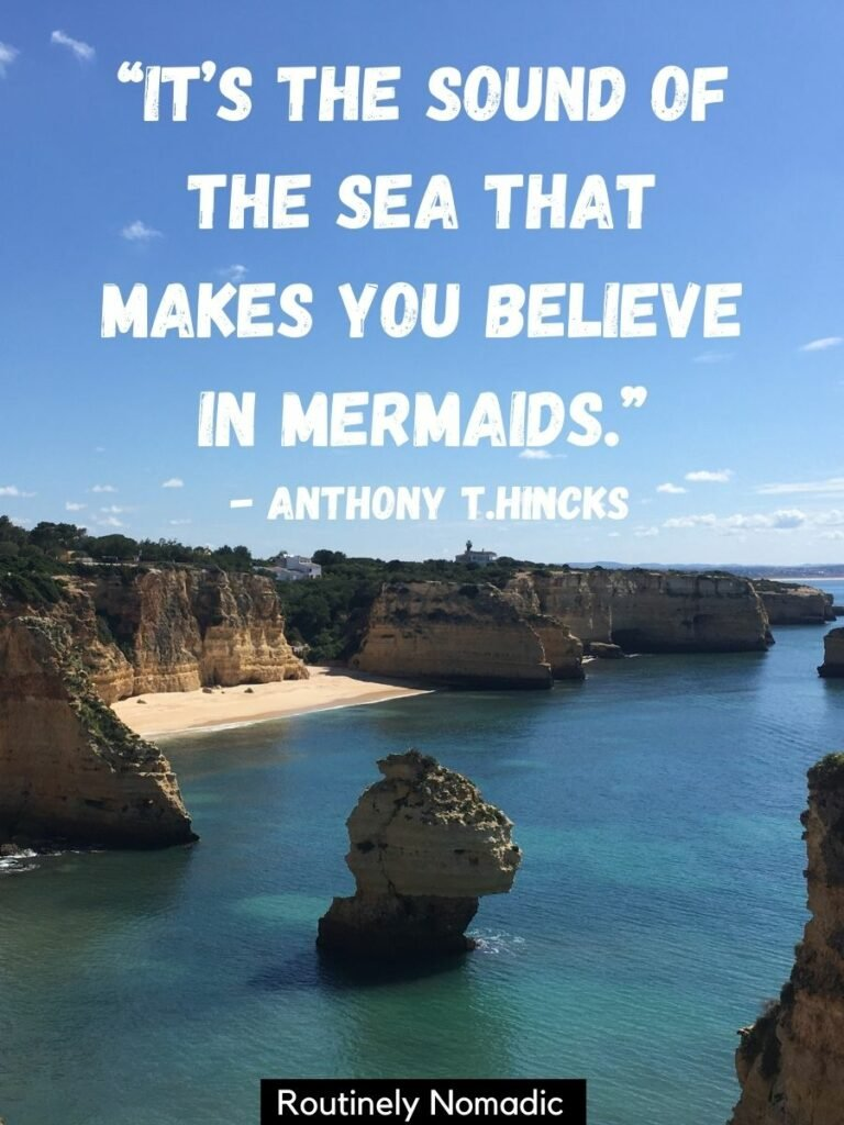 The sea, cliffs and a hidden beach with a by the sea quotes that reads It's the sound of the sea that makes you believe in mermaids