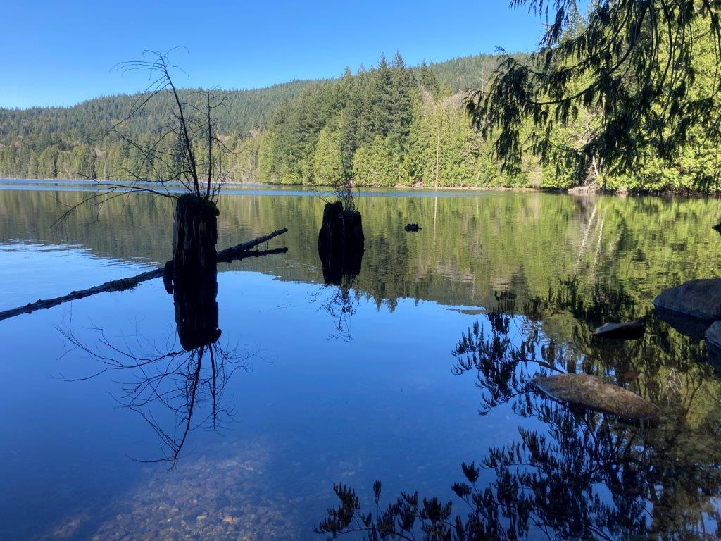 View of a reflective Killarney Lake - a Bowen Island hike